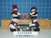 snowman holding metal box 2/s images