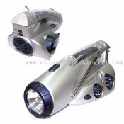 Crank Dynamo Flashlight with AM/FM Radio and mobile phone charger images