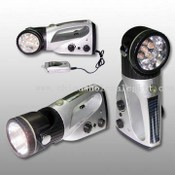 Crank Dynamo Flashlight with Radio and Mobile Phone Charger images