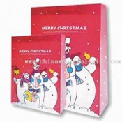 PP Carrier Bag with Merry Christmas Patterns and Red PP Strings images