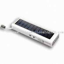 Solar FM Radio with Superbright LED Flashlight, Solar Panel and Cellphone Charger images