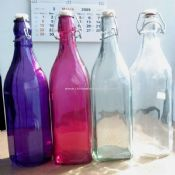 Multi color glass bottle with zinc ring and plastic top images