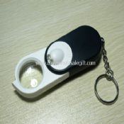 Illuminated Magnifier with Flashlight and Money Detector images