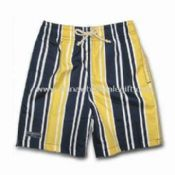 Boys Board Shorts with All-over Prints Two Side Pockets and One Rubber Badge on Right Leg images