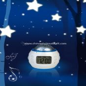 Alarm calendar clock with moving star projection light images