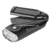 Solar Power Flashlight with Charger images