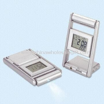 Multifunction LCD Clock Featuring with Thermometer Calendar Alarm FM Radio and Torch