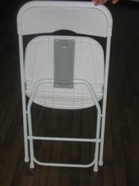 white metal-plastic folding chair