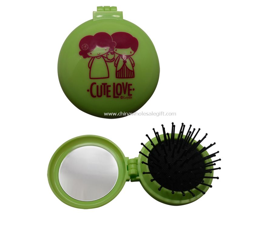 Cosmetic comb with mirror