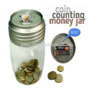 Transparent Coin counting Money Jar images